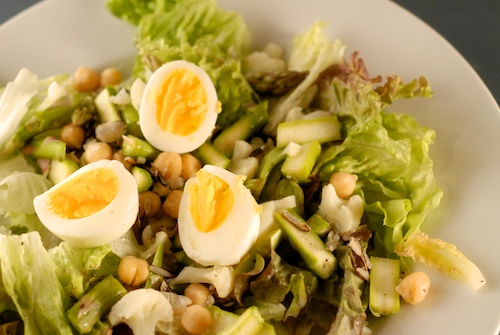 Early Spring Chopped Salad topped with hard-boiled egg slices