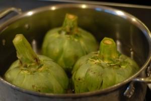 artichokes in the pot ready to steam