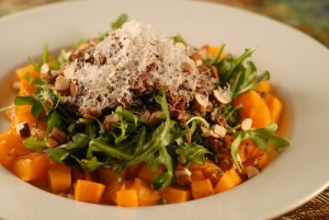 dinner salad with quinoa, lentil, arugula, and roasted butternut squash