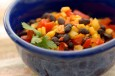 black bean, corn, red pepper and cilantro in a blue bowl
