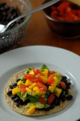 black bean tostado with tomatos, avocados, mango salsa (2)