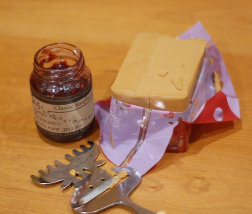 brunost, cheese slicer, and strawberry jam (1)