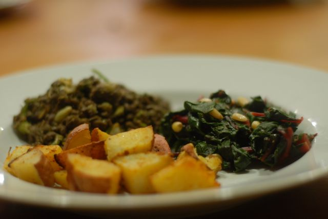 chard with pine nuts, lentil, and roast potato dinner