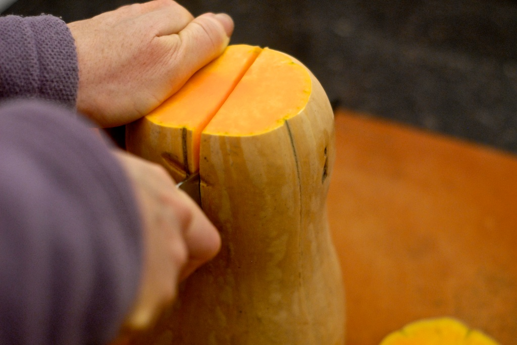 cutting butternut squash in half