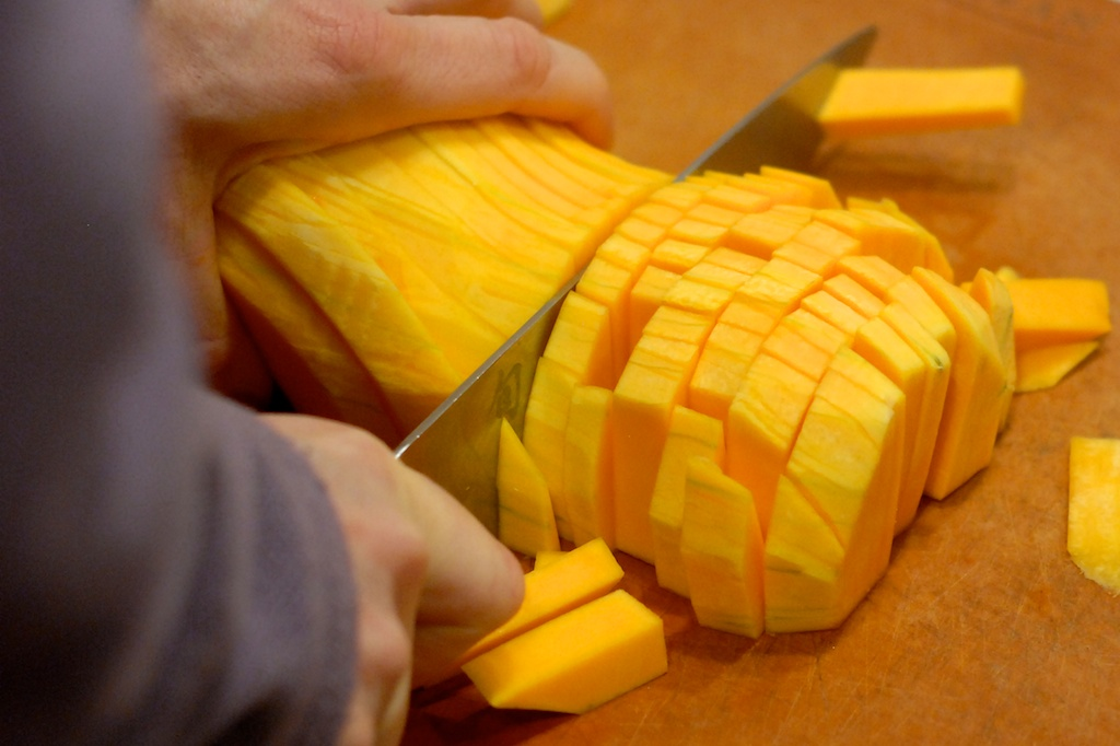 cutting sliced butternut squash into rounds