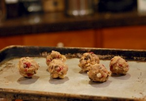 Dried cranberry macadamia nut chocolate chip cookies ready to go in the oven.