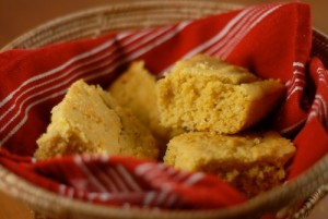 cornbread in basket with red kitchen towel