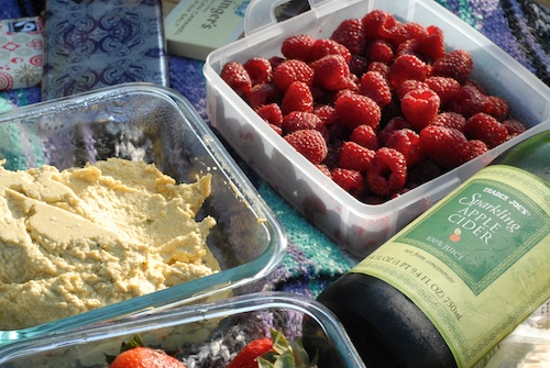 picnic sparkling cider and raspberries
