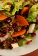 salad with pomegranate, Fuyu persimmon, pear, greens, and pomegranate dressing