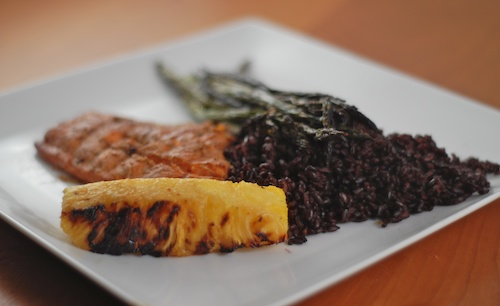 salmon dinner with black rice, grilled asparagus, grilled pineapple
