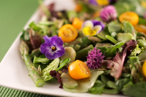 salad with violas and cherry tomatoes
