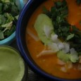 sweet potato vegetable soup with cilantro lime oil chopped cilantro and flaked coconut garnishes