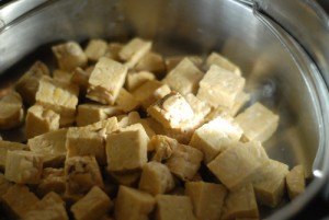 tempeh in a metal steaming insert in a pot