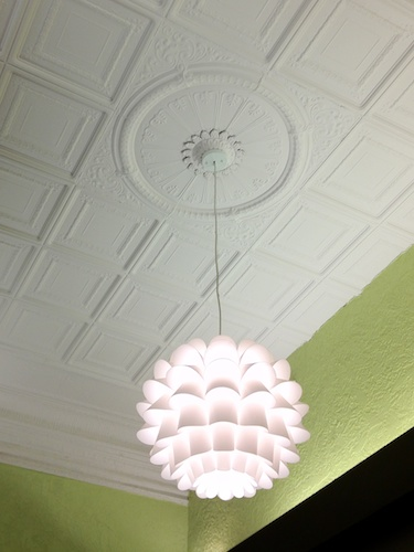 tin ceiling and flower light at Green Spoon