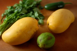 Ataulfa mangoes shown with lime jalapeno and coriander