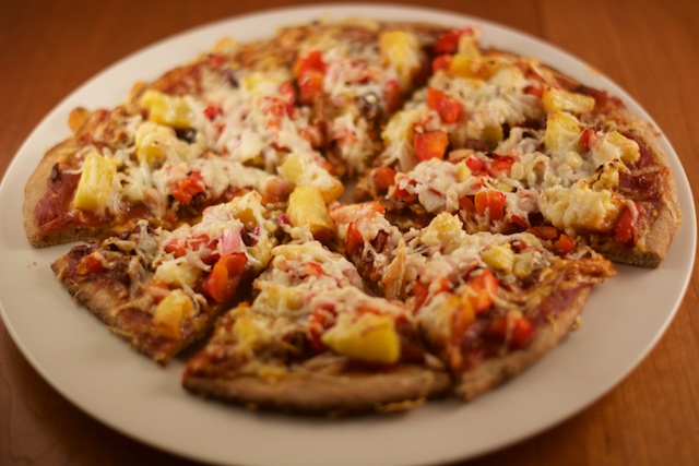 whole wheat pizza with pineapple, red pepper, Asiago and Parmesan